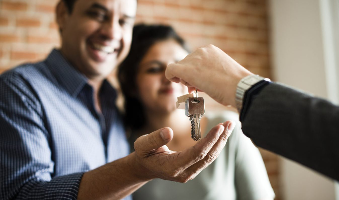 Cheerful Couple with keys to new home